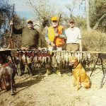 Hunters posing with pheasants they shot